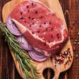 Raw fresh meat Ribeye Steak, seasoning. Royalty Free Stock Photos