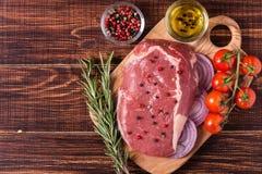 Raw fresh meat Ribeye Steak, seasoning. Royalty Free Stock Photography