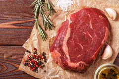 Raw fresh meat Ribeye Steak and seasoning. Stock Image
