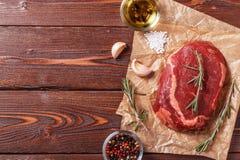 Raw fresh meat Ribeye Steak and seasoning. Royalty Free Stock Image