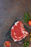 Raw fresh meat steak and seasonings Stock Photography