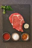 Raw fresh meat ribeye steak on stone slate royalty free stock photo