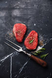 Raw fresh meat rump Steak and meat fork Stock Image