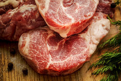 Raw Fresh Meat Slices on Wooden Chopping Board. Close up Raw Fresh Meat Slices on Wooden Chopping Board. Ready for Cooking Main Dish Stock Photos