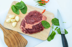 Raw Fresh Meat Slices on Wooden Chopping Board Royalty Free Stock Image