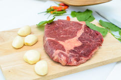 Raw Fresh Meat Slices on Wooden Chopping Board. Ready for Cooking Royalty Free Stock Photo