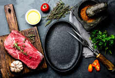 Raw fresh meat steak beef tenderloin, herbs and spices around frying pan plate. Food cooking ackground with copy space.  stock images
