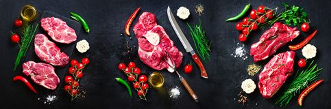 Raw fresh meat steak with cherry tomatoes, hot pepper, garlic, oil and herbs on dark stone, concrete background. Banner. Raw fresh meat steak with cherry stock photography