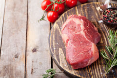 Raw fresh meat Steak on cutting board. Wooden background Copy space Royalty Free Stock Image