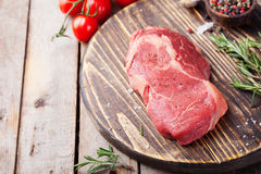 Raw fresh meat Steak on cutting board. Wooden background Copy space Royalty Free Stock Photo