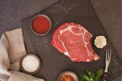 Raw fresh meat  steak ribeye on dark surface Stock Photo