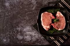 Raw fresh meat Steak Ribeye with rosemary and pepper on grill pan on wooden background stock images