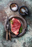 Raw fresh meat Striploin Steak and spices Stock Photos