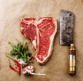 Raw fresh meat T-bone steak and cleaver Stock Images