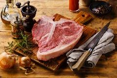 Raw fresh meat T-bone steak and seasoning Royalty Free Stock Photo