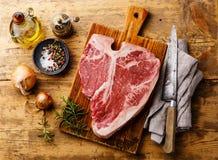 Raw fresh meat T-bone steak and seasoning Stock Photo