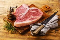 Raw fresh meat T-bone steak and seasoning Royalty Free Stock Photos