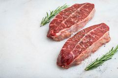 Raw fresh meat Top Blade steaks on light background. with copy space royalty free stock photo