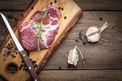 Raw fresh meat on wooden board. Royalty Free Stock Photography