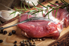 Raw fresh meat on wooden board. Royalty Free Stock Photos