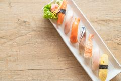 Raw and fresh nigiri sushi in white plate. Japanese food style Royalty Free Stock Photography