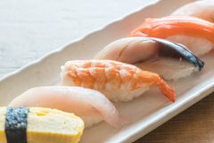 Raw and fresh nigiri sushi in white plate. Japanese food style Royalty Free Stock Images