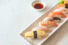 Raw and fresh nigiri sushi in white plate. Japanese food style Stock Photography