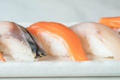 Raw and fresh nigiri sushi in white plate. Japanese food style Royalty Free Stock Photo