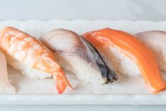 Raw and fresh nigiri sushi in white plate. Japanese food style Royalty Free Stock Photos