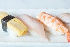 Raw and fresh nigiri sushi in white plate. Japanese food style Stock Photos