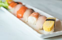 Raw and fresh nigiri sushi in white plate. Japanese food style Stock Images