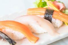 Raw and fresh nigiri sushi in white plate. Japanese food style Royalty Free Stock Image