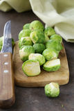 Raw fresh organic brussels sprouts. On cutting board Stock Photography