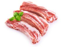 Raw fresh pork ribs and basil isolated on white background. With clipping path Stock Photos