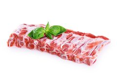 Raw fresh pork ribs and basil. On white background stock images