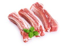 Raw fresh pork ribs and basil  on white background. With clipping path Royalty Free Stock Images