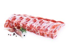 Raw fresh pork ribs, garlic, pepper and rosemary. Isolated on white background royalty free stock images