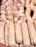 Raw fresh pork sausages for grilling Royalty Free Stock Images