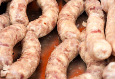 Raw fresh pork sausages for grilling Stock Photo