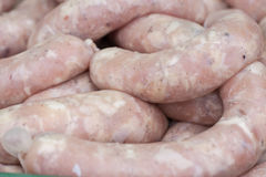 Raw fresh pork sausages for grilling. Selective focus Royalty Free Stock Photo