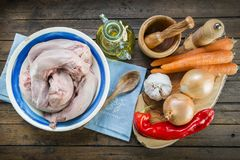 Raw pork tongues and ingredients to cook. Raw and fresh pork tongues meat and ingredients to cook Stock Photography