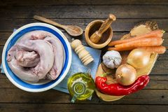 Raw pork tongues and ingredients to cook. Raw and fresh pork tongues meat and ingredients to cook Royalty Free Stock Photo