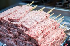 Raw fresh pork with wooden skewer for sell. In street food market Stock Photos