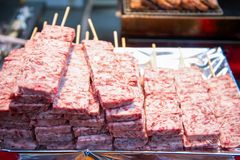 Raw fresh pork with wooden skewer for sell. In street food market Royalty Free Stock Photography