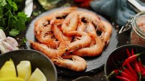 Raw fresh prawns with various ingredients such as lemon fresh herbs, garlic, chilli pepper