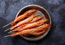 Raw fresh red Prawns on skewers Stock Images