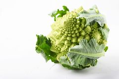 Raw fresh Roman cauliflower on the wooden table. Selective focus Stock Images