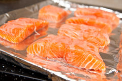 Raw fresh salmon fillet on foil Royalty Free Stock Photos