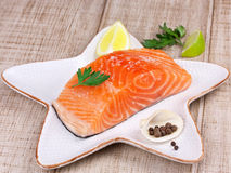 Raw fresh salmon on a plate Royalty Free Stock Image