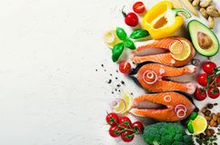Raw fresh salmon steak with vegetables. Ingredients for cooking on white background. Space for text. Diet and healthy. Food concept. Banner Royalty Free Stock Image